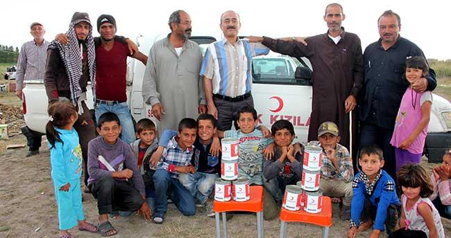 Seydişehir'de Suriyeli tarım işçilerine kavurma dağıtıldı