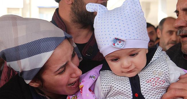Şehit eşini 9 aylık bebeğiyle uğurladı
