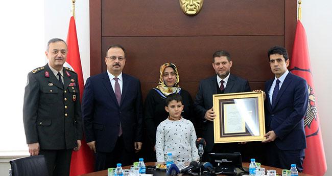 Konya'da 1 şehit ailesi ile 2 gaziye Devlet Övünç Madalyası ve Beratı