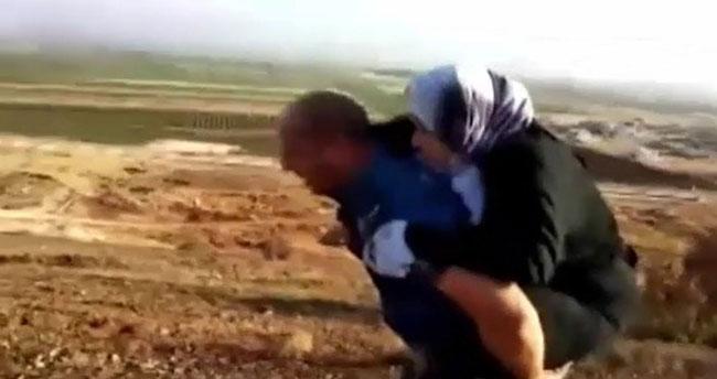 Yaralı Suriyeliyi 2 kilometre sırtında taşıyan polise ödül