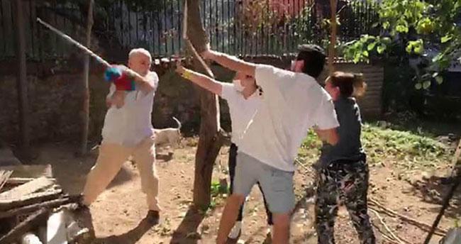 Komşular arasındaki sopalı kavga kamerada