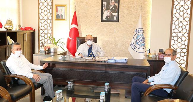 """Başkan Tutal'dan Belediye Başkanı Bayındır'a """"geçmiş olsun"""" ziyareti"""
